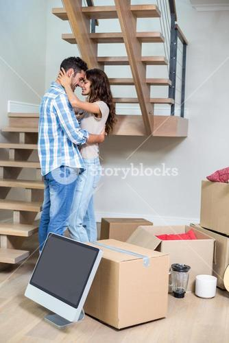Side view of romantic couple hugging