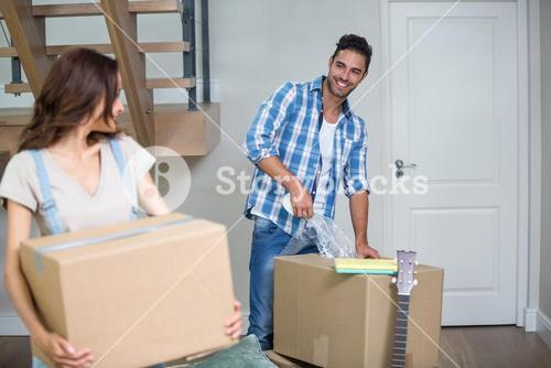 Smiling couple with cardboard box