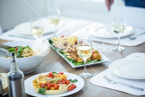 Food and wine served on table