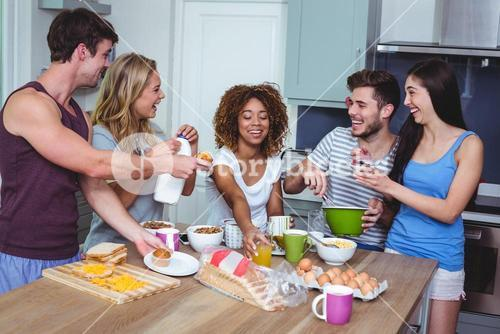 Cheerful young friends with food