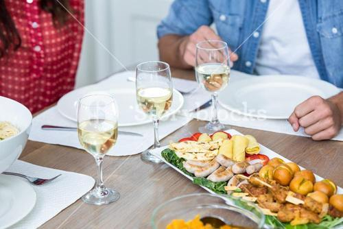 Midsection of people with food served on table