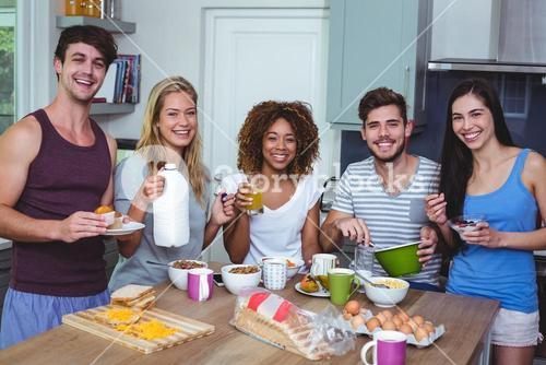 Portrait of smiling friends with food