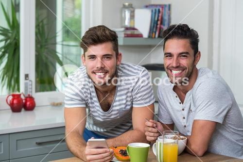 Portrait of male friends with phone