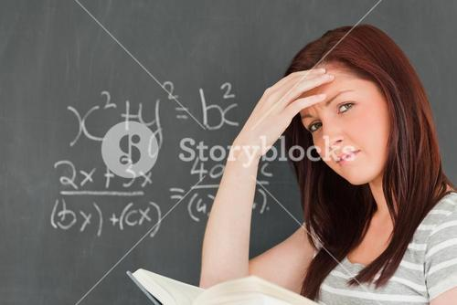 Thoughtful woman trying to solve an equation