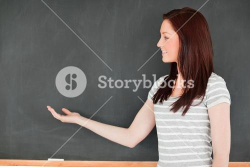 Redhead against a blackboard with a copy space