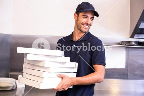 Pizza delivery man carrying boxes