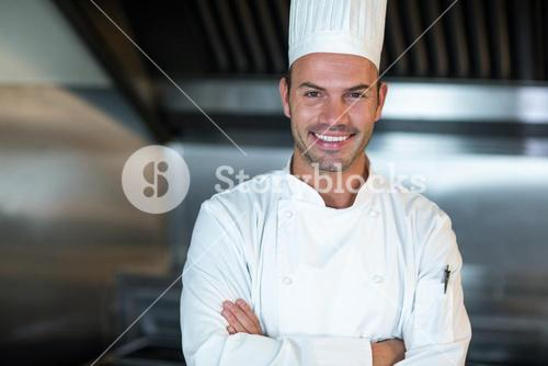 Happy chef in commercial kitchen