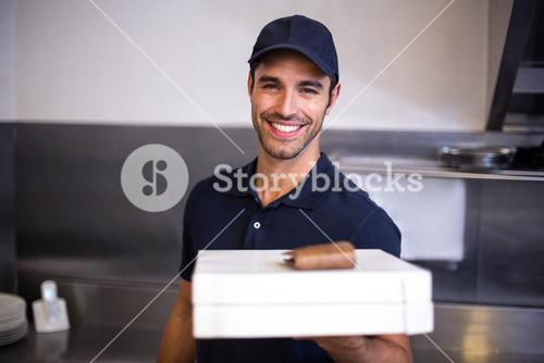 Pizza delivery man showing box