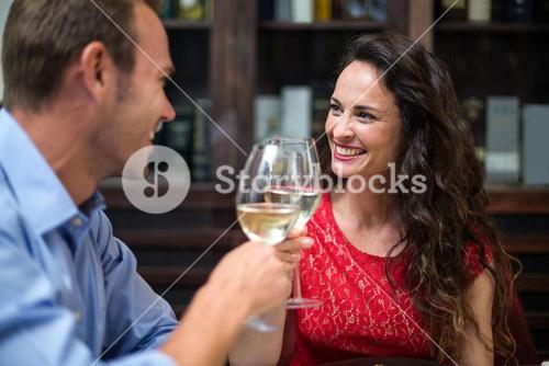 Happy couple toasting champagne flutes