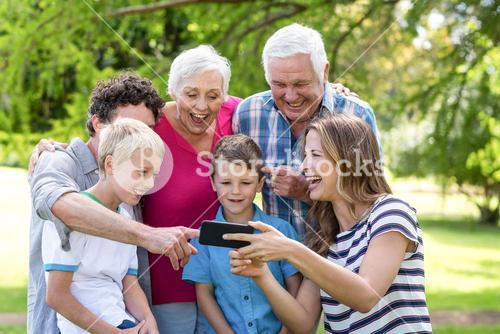 Smiling family using smartphone