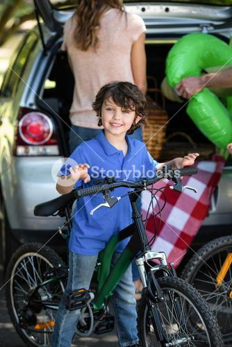Smiling boy with his bike
