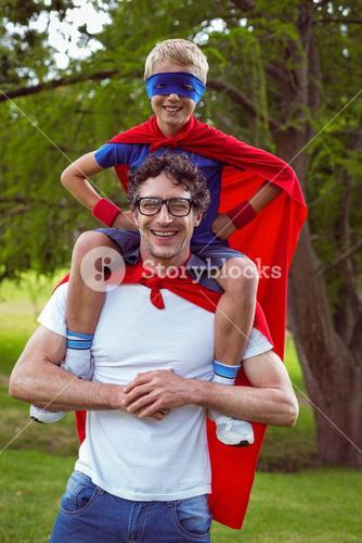 Father and son dressed as superman