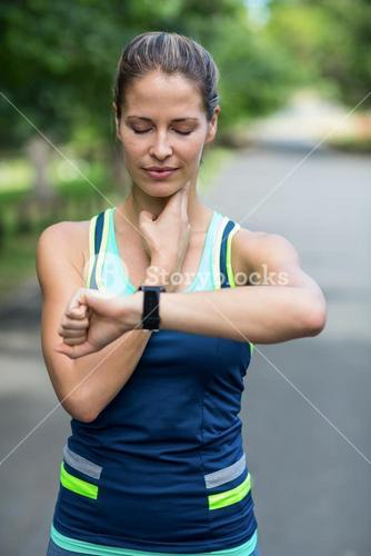 Sportswoman checking her heart rate watch