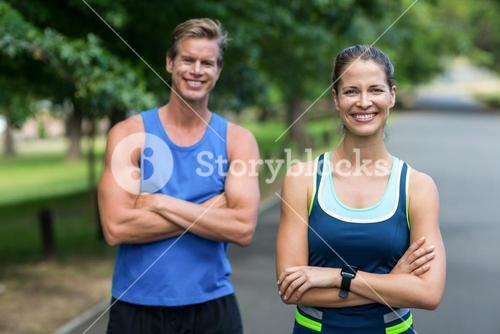 Fit people posing with crossed arms