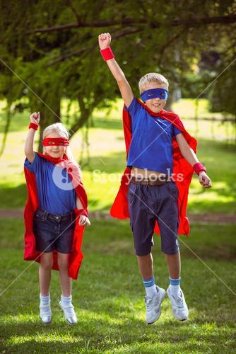 Brother and sister pretending to be superhero