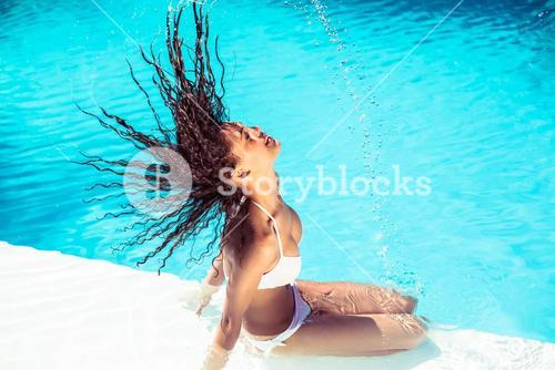 Beautiful woman tossing her wet hair