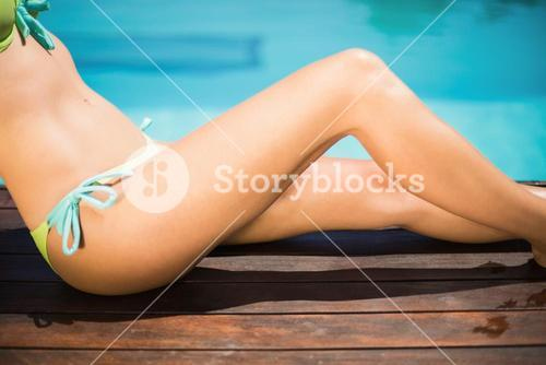 Gorgeous woman sitting by poolside