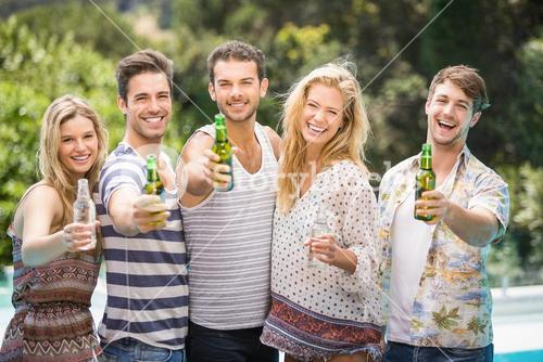 Group of friends showing their beer bottles