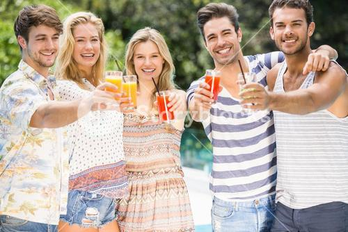 Group of friends showing their glass of juice