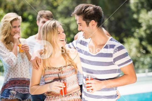 Young couple smiling and having juice together
