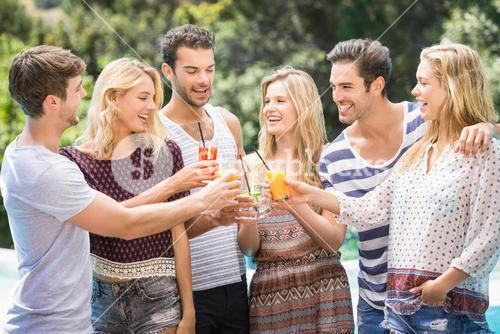 Group of friends toasting their juice glasses