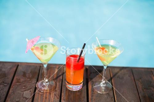 Cocktail glasses on wooden deck