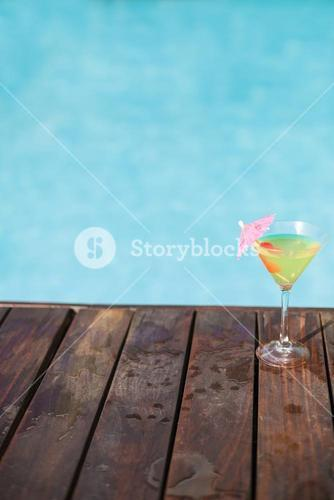 Cocktail glass on wooden deck