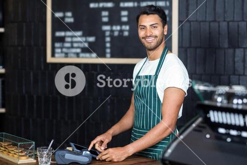 Pretty barista using cash register