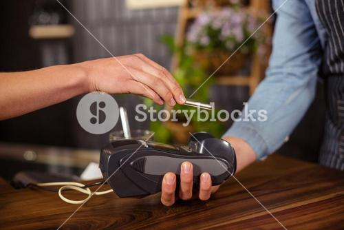 Female customer paying with smartphone