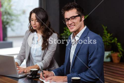 Business people working with laptop and coffee