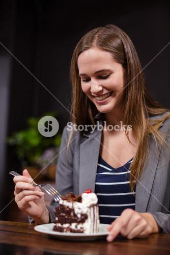 Smiling woman about to eat cake