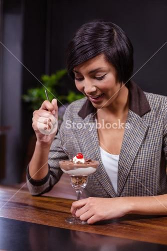 Pretty woman about to eat dessert