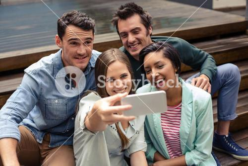 Happy friends taking selfie