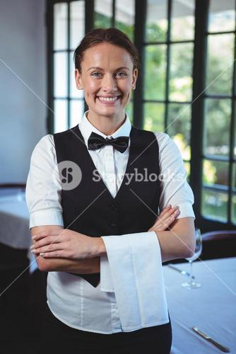 Waitress posing with crossed arms