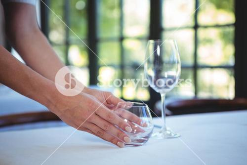 Waitress setting the table