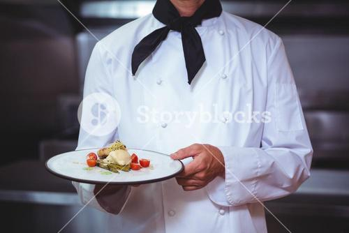 Proud chef holding a plate