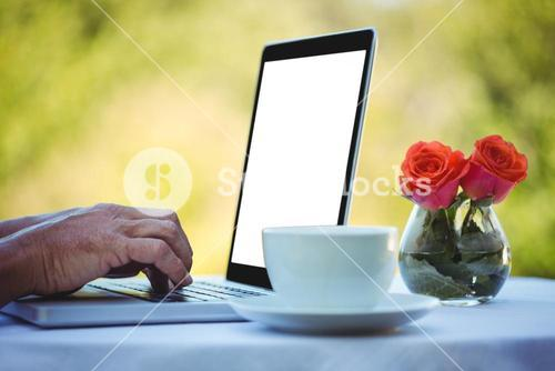 Masculine hands typing on a laptop