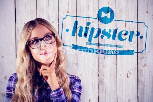 Composite image of gorgeous smiling blonde hipster daydreaming