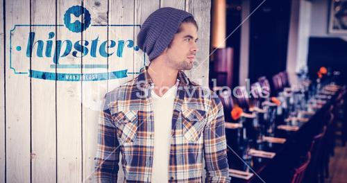 Composite image of confident hipster looking away while standing
