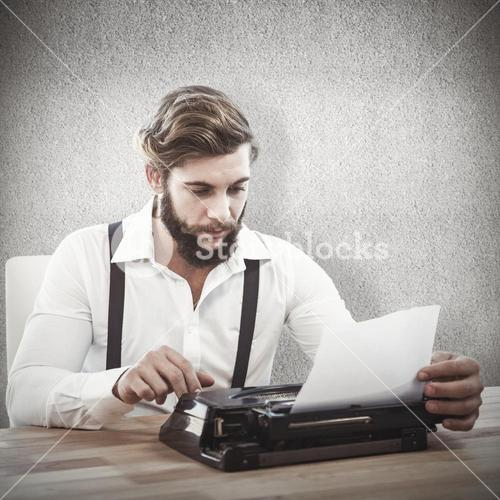 Composite image of hipster using typewriter at desk in office