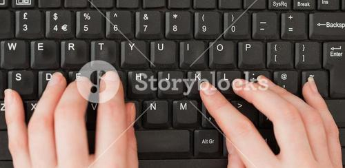 Woman hands typing on a keyboard