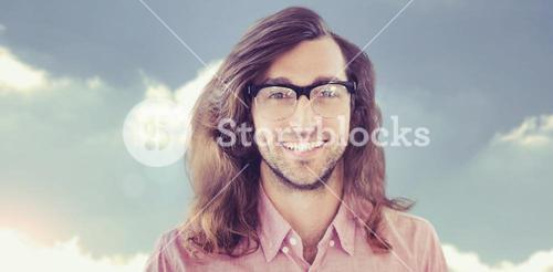 Composite image of happy hipster wearing eye glasses