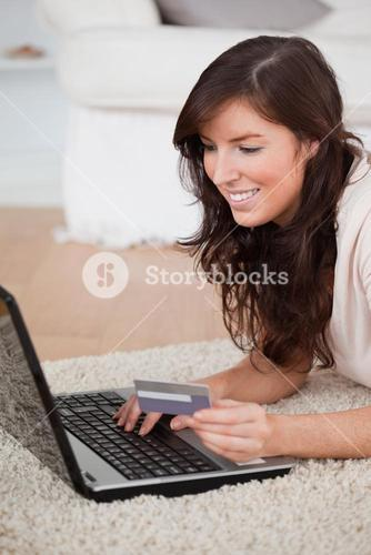 Young attractive woman making a payment