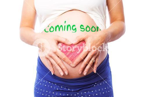 Composite image of pregnant woman holding her bump