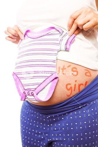 Pregnant woman holding pyjamas over her belly