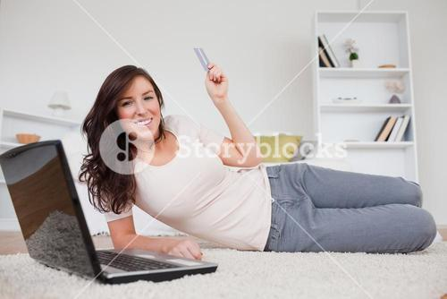 Attractive brunette female making a payment