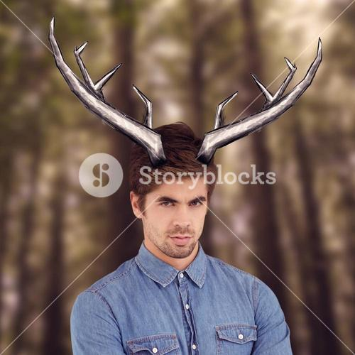 Composite image of portrait of hipster with arms crossed