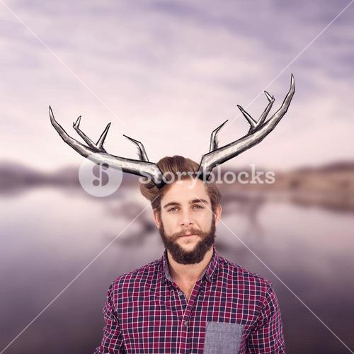 Composite image of portrait of confident hipster with clenched fist