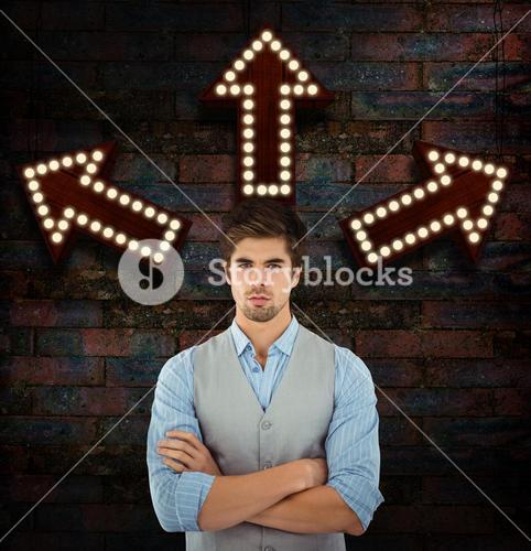 Composite image of confident businessman standing against wooden wall