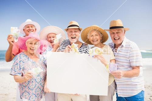 Senior friends holding blank paper and money